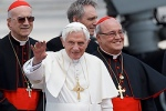 Pope Benedict XVI waves as he arrives at Jose Marti International Airport in Havana March 27. Behind the pope is Cardinal Tarcisio Bertone, the Vatican Secretary of State, and Cardinal Jaime Ortega Alamino of Havana. (CNS file photo/Paul Haring)