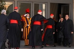 A Swiss Guard salutes as U.S. Cardinals Roger M. Mahony, retired archbishop of Los Angeles, Edward M. Egan, retired archbishop of New York, and Donald W. Wuerl of Washington arrive for the first general congregation meeting in the synod hall at the Vatican March 4. (CNS photo/Paul Haring)