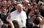 Pope Francis gives thumbs up as he greets crowd while arriving for general audience in St. Peter's Square at Vatican