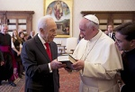 "Israeli President Shimon Peres hands a copy of the Scriptures in English and Hebrew to Pope Francis during a private meeting at the Vatican April 30. Peres officially invited the pope to Israel and left their meeting telling him, ""I am expecting you in Jerusalem and not just me, but all the people of Israel."" (CNS photo/Ettore Ferrari, pool via Reuters)"