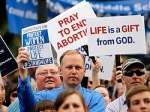 Protesters hold signs during an anti-abortion rally at the Texas Capitol in Austin July 8.