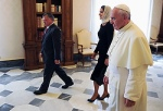 Pope Francis walks with Jordan's King Abdullah II and wife during private meeting at Vatican