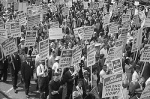 Demonstrators holding signs march during the 1963 March on Washington. As the 50th anniversaries of key civil rights events approach, some observe that there's still a long way to go toward eliminating racism in U.S. society. (CNS photo/Library of Congress)