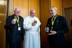 Pope Francis drinks mate, the traditional Argentine herbal tea, during a break at a meeting with the superiors of men's religious orders at the Vatican Nov. 29. During the meeting, the pope ordered the revision of norms on the relations between religious orders and local bishops. At right is Father Adolfo Nicolas, superior general of the Society of Jesus. (CNS photo/L'Osservatore Romano)