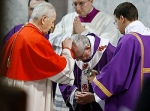 Pope Francis receives ashes from Slovakian Cardinal Jozef Tomko during Ash Wednesday Mass at the Basilica of Santa Sabina in Rome March 5. (CNS photo/Paul Haring)