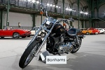 "This Harley Davidson Dyna Super Glide motorcycle, donated to Pope Francis last year, is displayed as part of Bonham's Les Grandes Marques du Monde vintage and classic cars sale in Paris Feb. 5. Signed ""Francesco"" on its tank, the motorcycle was auctioned for charity in Paris Feb. 6. The pope sold his Harley Davidson to raise funds for Caritas, the Rome diocesan charity."