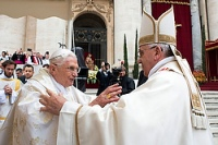 Retired Pope Benedict XVI embraces Pope Francis before canonization Mass at Vatican
