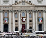 Tapestry portraits of Sts. John Paul II and John XXIII seen during canonization Mass at Vatican