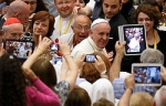 People take photos on tablets and phones as Pope Francis arrives to opens the annual convention of the Diocese of Rome in Paul VI hall at the Vatican June 16. In his talk, the pope responded to concerns about the difficulties of keeping families active i n parish life. (CNS photo/Paul Haring)