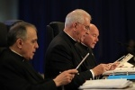Cardinal Daniel N. DiNardo of Galveston-Houston, vice president of the U.S. Conference of Catholic Bishops, Archbishop Joseph E. Kurtz of Louisville, Ky., USCCB president, and Msgr. Ronny E. Jenkins, USCCB general secretary, pray June 11 during the annua l spring meeting of the U .S. Conference of Catholic Bishops in New Orleans. (CNS photo/Bob Roller)