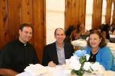 Father Michael Slovak, Joe and Linda Domino
