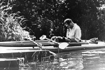 Father Karol Wojtyla, the future Pope John Paul II, is pictured reading in a kayak in this photo dated 1955. Less than six months after St. John Paul II was canonized, questions are being raised about a book of lectures he penned on social ethics as a yo ung priest in his Polish homeland.(CNS photo)