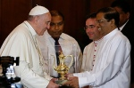 Pope Francis accepts a gift from Sri Lankan President Maithripala Sirisena during a visit in a presidential office in Colombo, Sri Lanka, Jan. 13. (CNS photo/Paul Haring)