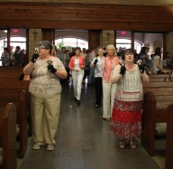 St. Jude Handbell Choir plays as parishioners enter the church.