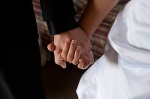 Groom, bride hold hands on wedding day