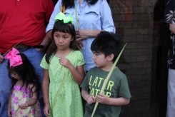 7-, Ava and Ramon Hernandez hold the palms they received at St. Jude.