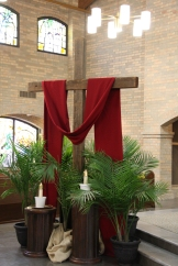 7-s surrounded by palms stands inside St. Jude Thaddeus Church